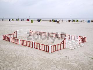 Fenced-in beach ball court