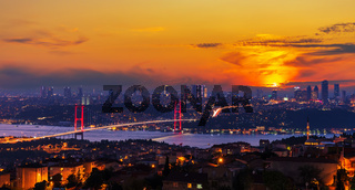 Bright sunset and the Boshporus Bridge in Istanbul, view from the Asian side, Turkey