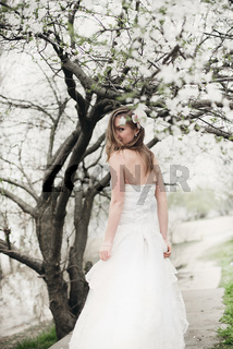 Beautiful bride in spring blossom