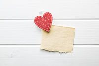 Red heart with gift card.