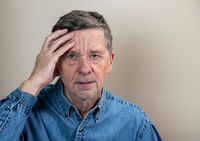 Senior caucasian elderly retiree looking depressed and anxious