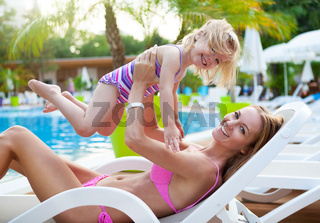 Happy family in the pool, having fun