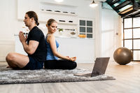 White caucasian couple do sit yoga at home