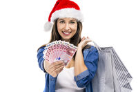Santa woman with money and shopping bags