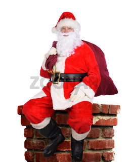 Santa Claus with his bag of toys sitting atop a chminey, isolated on white.