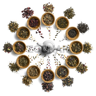 Large tea set in the shape of a clock face. Top view on white background