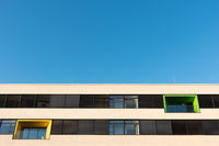 Two different colored balconies of a modern building