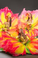 Showgirls in bright fantastic flowers costume portrait
