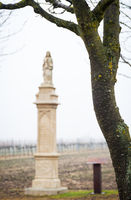 Statue of a saint on a column in Burgenland