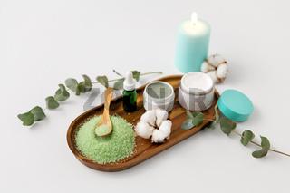 bath salt, serum, moisturizer and oil on tray