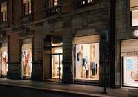 Historical buildings, stores and boutique shops on Via Montenapoleone street in Milan at night, luxury shopping street
