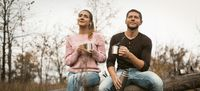 Young Couple Have Rest Drinking Hot Coffee In Nature