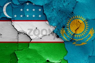 flags of Uzbekistan and Kazakhstan painted on cracked wall