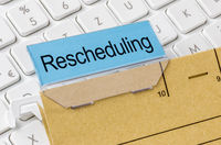 A brown file folder labeled with Rescheduling