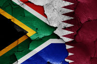 flags of South Africa and Qatar painted on cracked wall