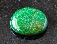 tumbled green Aventurine gem stone on black