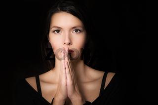 Spiritual young woman praying