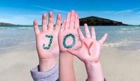 Children Hands Building Word Joy, Ocean Background