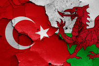 flags of Turkey and Wales painted on cracked wall