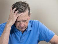 Senior caucasian elderly retiree looking depressed and anxious
