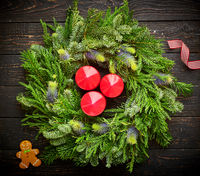 Christmas wreath on dark wooden background