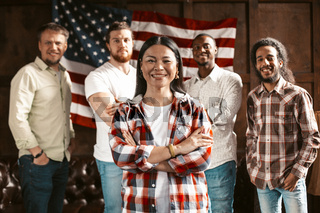 Multi-Ethnic Team Of Young American Entrepreneurs Rejoices In Successful Start Up