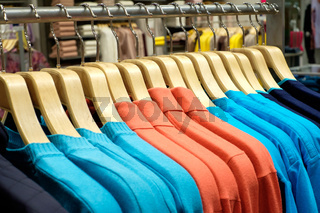 Clothing on hangers in shop