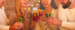 Friends drinking cocktail at party