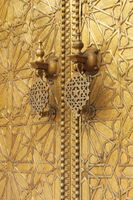 The golden door knockers of the Royal Palace in Fes