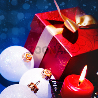 Christmas background with candle and decorations on blue