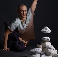 Man sitting on the floor in yoga pose studio shot