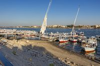 Public Baladi ferry boats docking by the jetty at the East Nank of the Nile River
