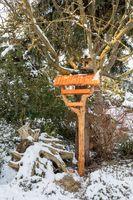 simple birdhouse in winter garden