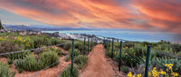 Hiking trail above Dana Point city view at sunset