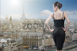 Young elegant woman looking on Paris with Eiffel tower