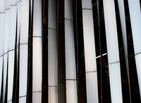modern stylish steel vertical curved panels in vertical pattern exterior cladding