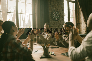 Creative Team Of Freelancers Applauding Together