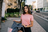 Young woman with open backpack on the street