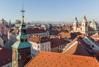 Scenic panoramic aerial drone view of rooftops of medieval city center, town hall and cathedral church in Ljubljana, capital of Slovenia, at sunset