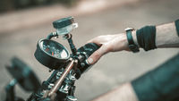 Male Hand Holding Wheel Of Motorbike Outdoors