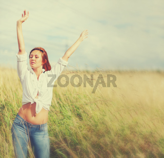 Relaxed woman outdoors in late summer meadow
