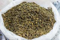 Heap of green tea at street market in asian town