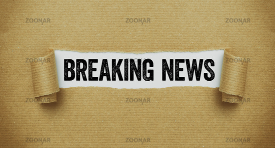 Torn paper revealing the words Breaking news