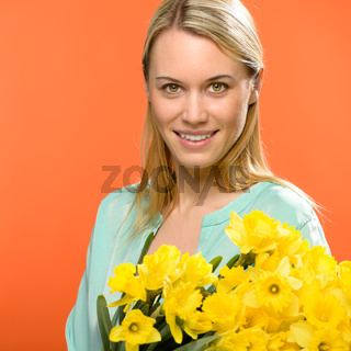 Spring woman hold yellow narcissus flowers