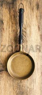 Old used pan on rustic wood