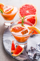 Fresh pink grapefruit drink with juice. Cold summer citrus refreshing drink or beverages with rosemary.