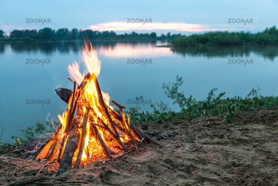 Beautiful bonfire by the river.