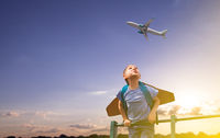 Boy standing high and looking at the airplane