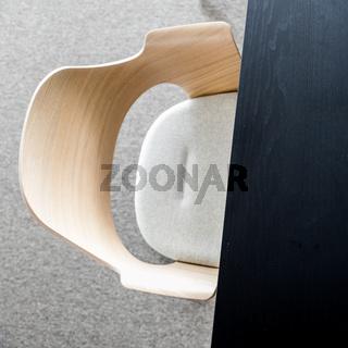 Designers armchair by black office desk. Modern minimalist workplace