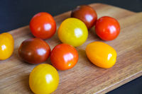 Cocktail tomatoes on a cutting board